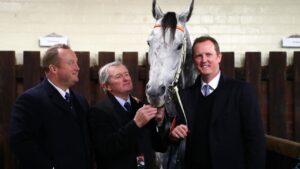 John Hawkes with sons Wayne and Michael with superstar Chautauqua. Picture: AAP