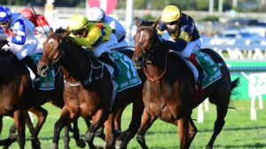 Tofane (outside) beats Vega One in the Stradbroke Handicap at Eagle Farm on Saturday. Picture: Grant Peters/Trackside Photography