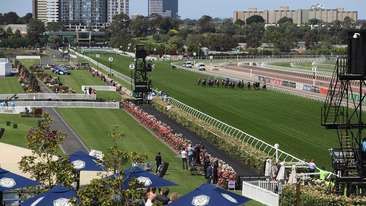 Horses race down the straight in front of no crowd in the 2020 Melbourne Cup. Picture: Alex Coppel.