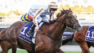 Dice Roll surging to victory at Flemington under jockey Fred Kersley. Picture: Racing Photos