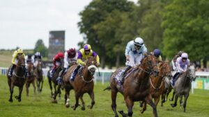 Tom Marquand celebrates as Starman crosses the line to win The Darley July Cup at Newmarket. Picture: Photo–Alan Crowhurst/Getty Images