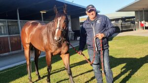 Trainer Rob Heathcote and his star galloper Rothfire after a full-throttle gallop at Eagle Farm on Tuesday morning. Picture: Rob Heathcote