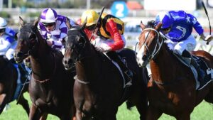 Boomsara (centre) fights off Ef Troop and Matowi to win at Eagle Farm. Picture: Trackside Photography
