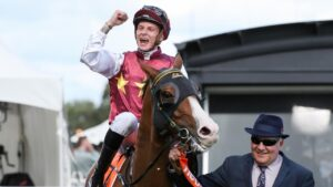 Zac Spain returns to the mounting yard aboard Streets of Avalon after winning the CF Orr Stakes. Picture: Racing Photos