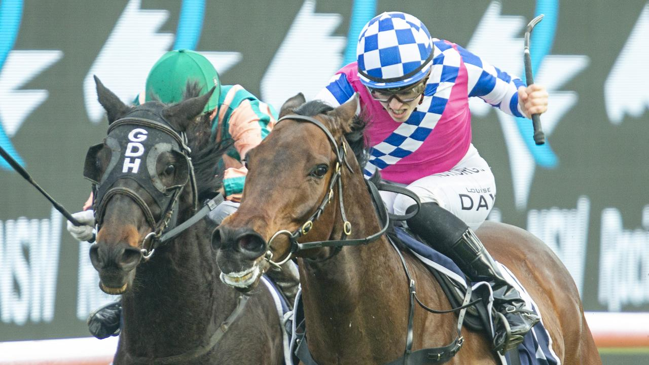 Louise Day (pink) on Man Of Peace at Royal Randwick. Photo: Jenny Evans/Getty Images