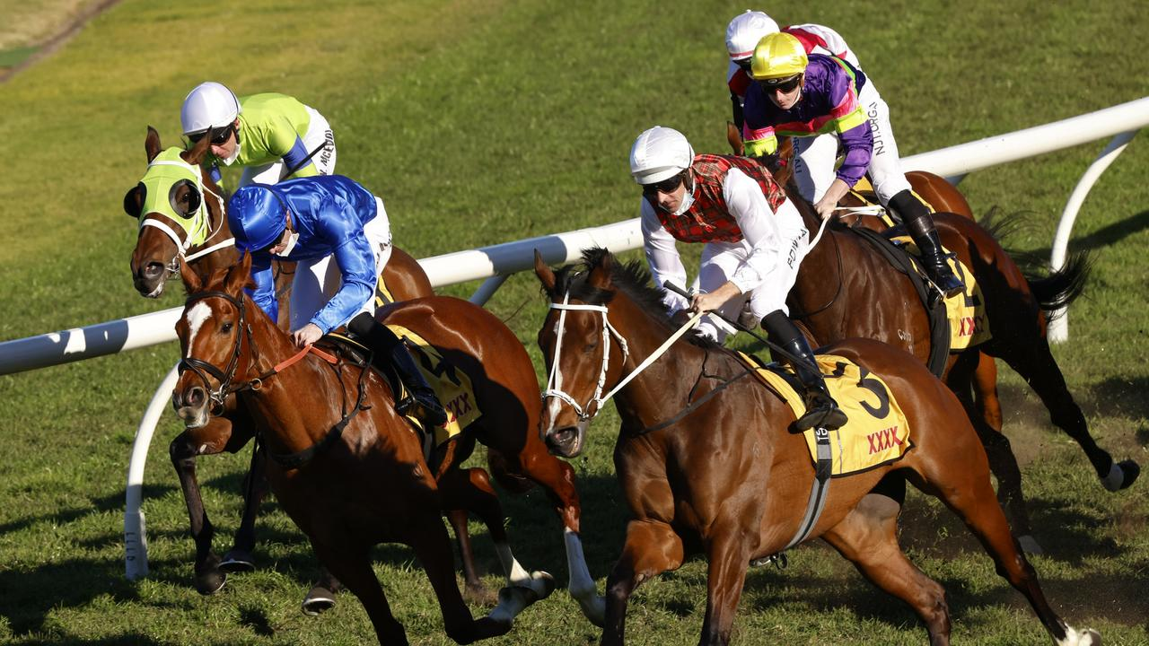 Hugh Bowman on Order Again (white/tartan) get over the top of Ziegfeld to win the XXXX Winter Challenge at Rosehill Gardens. Picture: Photo by Mark Evans–Getty Images