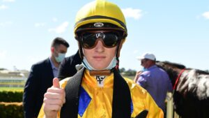 Apprentice Kyle Wilson-Taylor rides his first Saturday city winner, Hinged. Pic - Grant Peters, Trackside Photography.