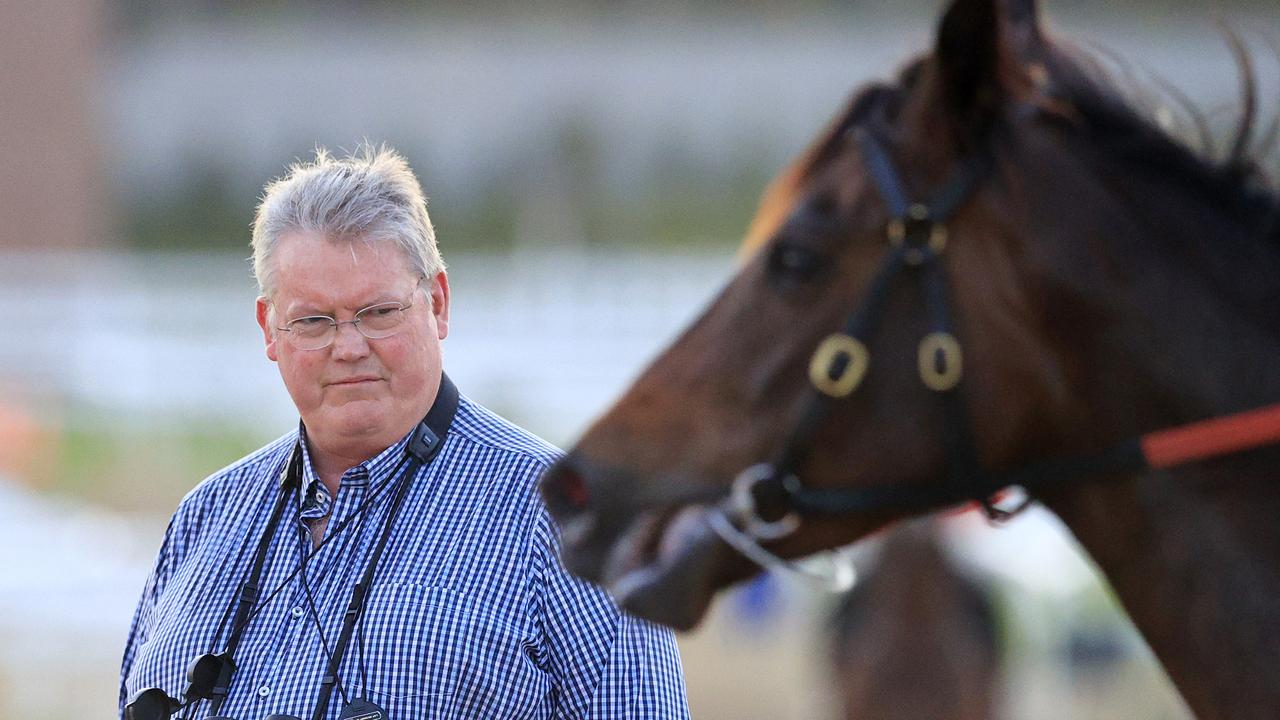 Trainer Anthony Cummings has a busy morning at the trials. Photo: Mark Evans/Getty Images