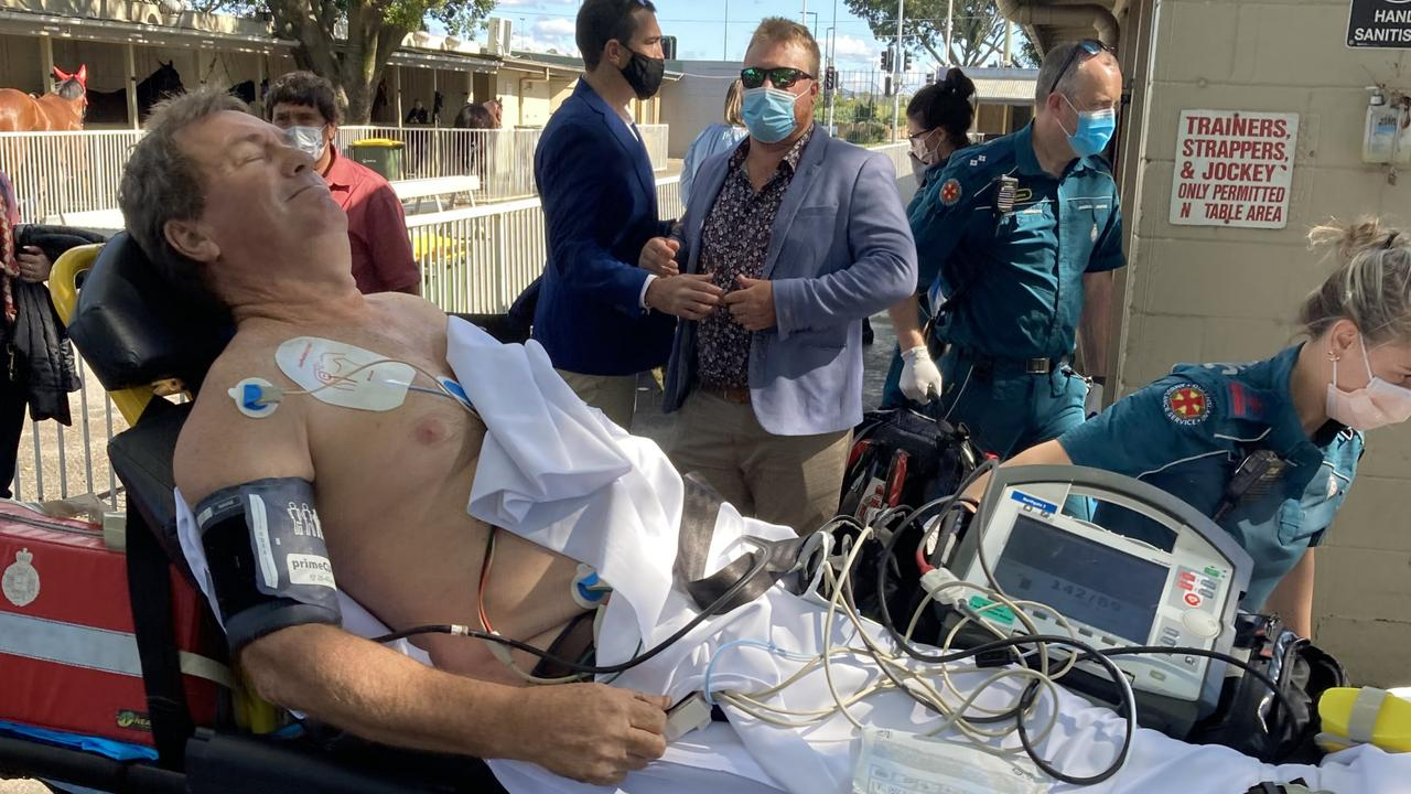 Trainer Gary Duncan being stretchered to an ambulance after he was revived at Doomben last Saturday. Picture: Ben Dorries