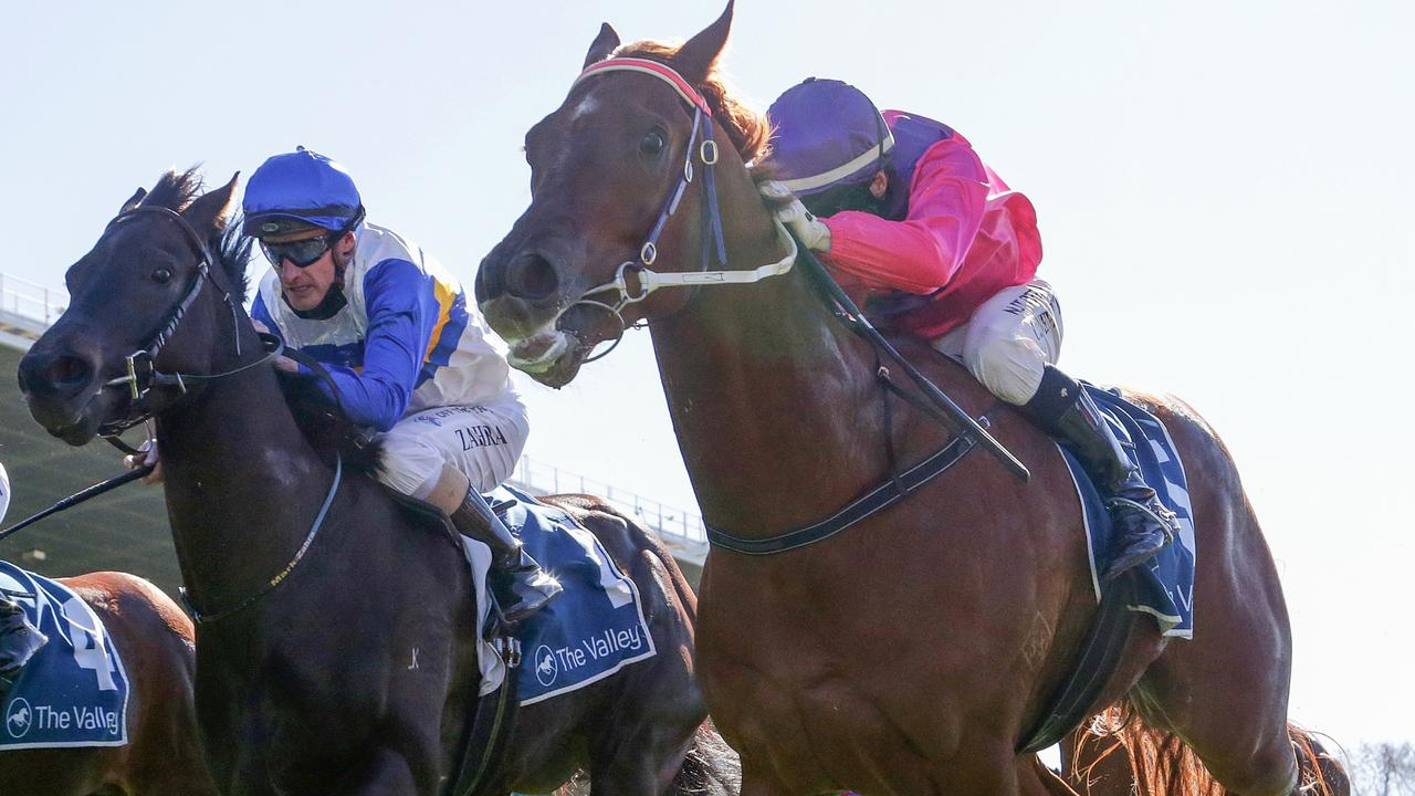 Rock Artist (right) holds on for victory at The Valley. Picture: Racing Photos via Getty Images
