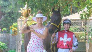 Darwin Cup ambassador Hannah West, Jockey Jason Lyon and I Am The Fox ahead of Monday's Darwin Cup. Picture: Glenn Campbell