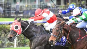 Jockey Craig Newitt drives $41 chance Yulong Storm to surprise win at Flemington in July. Picture : Racing Photos via Getty Images.