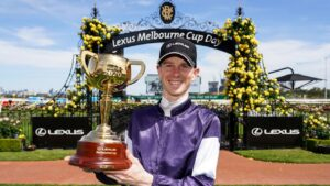 Jye McNeil with the Melbourne Cup after winning last year with Twilight Payment. Picture: AFP