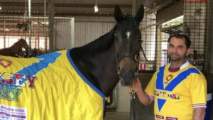 Champion mare Verry Elleegant and her strapper sport the Jersey Day colours. Picture: Chris Waller Racing