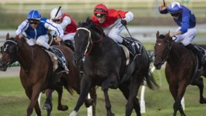 Command'n'conquer bolting to victory at Doomben under jockey Jimmy Orman. Picture: AAP