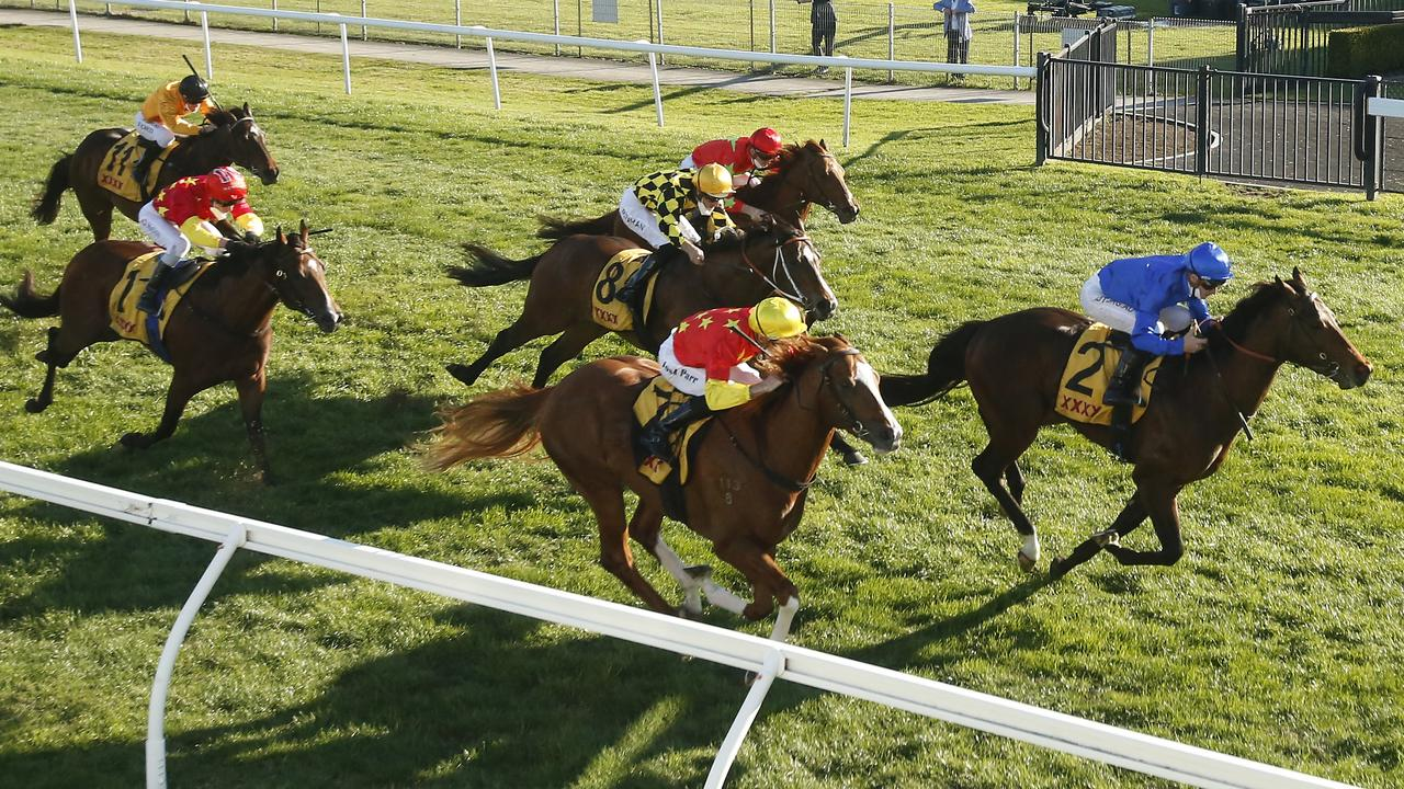 Stay Inside (red and yellow sleeves, red cap) finishing fifth behind Anamoe in last Saturday's Run To The Rose. Photo: Mark Evans/Getty Images.