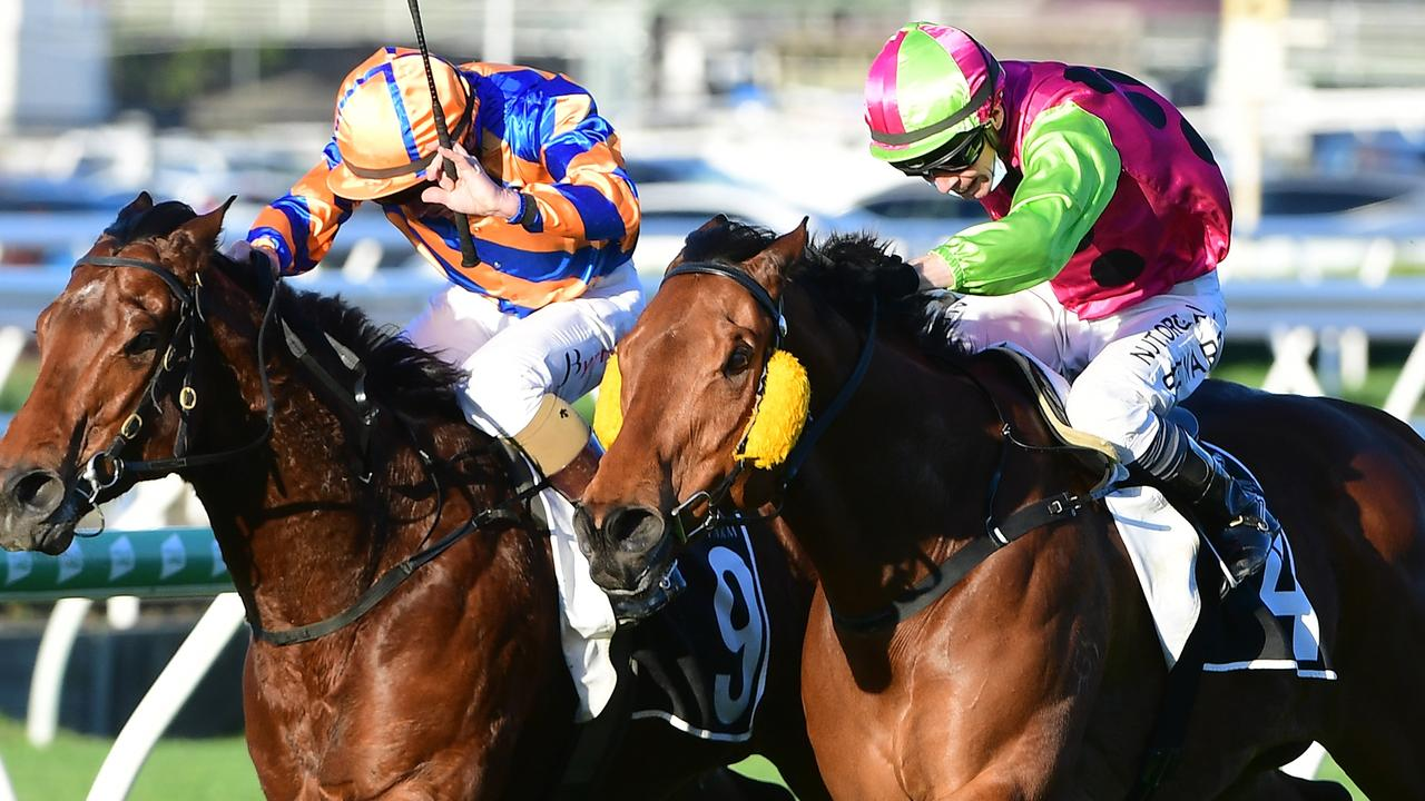 The Gary Clem-trained King Klaus (right) is driven out to win at Eagle Farm under jockey Ronnie Stewart. Picture: Trackside Photography