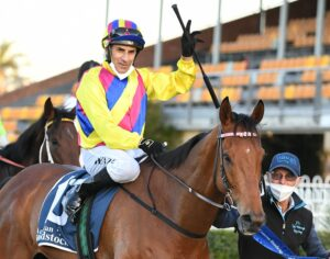Jeff Penza returns to scale aboard ashman after winning the Cameron Handicap at Newcastle on Friday. Photo: Steve Hart.