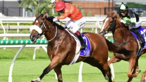 Apache Chase keeps kicking to win at Eagle Farm. Picture: Grant Peters—Trackside Photography.