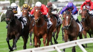 Harbour Views (white sleeves) finishing over the top of Cherry Tortoni (red) and Ayrton (blue) at Flemington when resuming. Picture: Racing Photos–George Salpigtidis