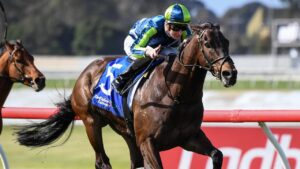 Teo Nugent surging to victory aboard Floating Artist at Sandown Hillside. Picture: Racing Photos