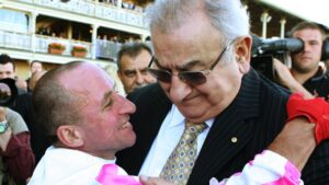 Nick Moraitis celebrates a Might And Power win with jockey Jim Cassidy.