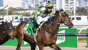 Brett Prebble urges Incentivise to victory in the Turnbull Stakes at Flemington. Picture: Racing Photos via Getty Images