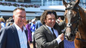 Training partners Mathew Ellerton (left) and Simon Zahra celebrating Zoutori's Newmarket Handicap win in March. Picture: Racing Photos via Getty Images