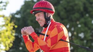 Jim Byrne returns after winning the Weetwood Handicap at Toowoomba aboard Apache Chase. Picture: Nev Madsen.