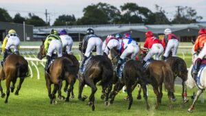 The field in race three rounds the first corner at Toowoomba Turf Club Clifford Park racecourse, Saturday, March 13, 2021. Picture: Kevin Farmer