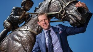 Hugh Bowman, with a statue of Winx, is looking forward to his return to The Valley. Picture: Tony Gough