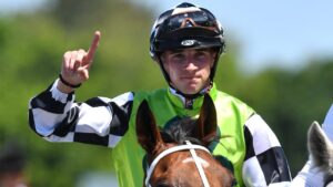 Jockey Lee Magorrian returns after riding a winner on the Gold Coast. Picture: AAP Image—Darren England.