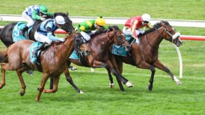Wentwood (red silks), ridden by Harry Coffey, staves off Taramansour (green and gold) and Smokin' Romans (blue and black) to win the Bendigo Cup. Picture: Racing Photos via Getty Images